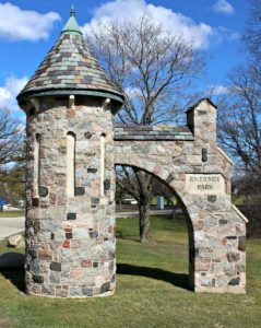 A pair of stone turrets mark the entrance to Riverside Park in Janesville, Wisconsin